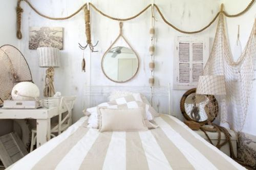 Coastal bedroom decorated with nautical decor