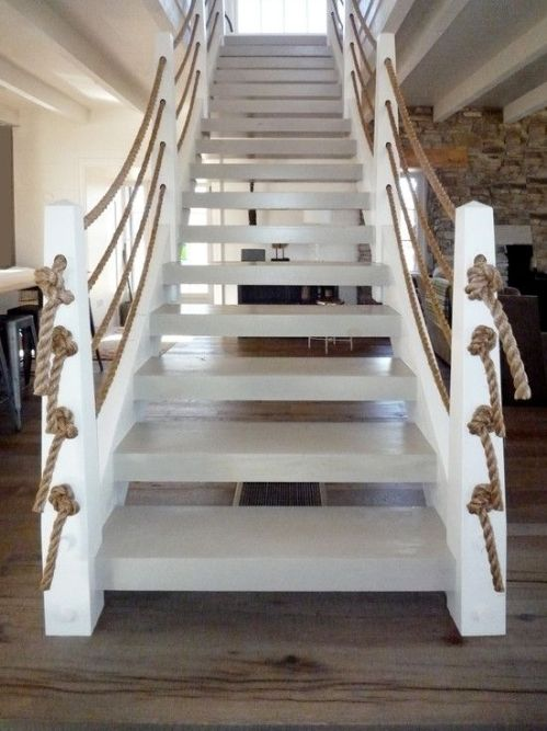 Coastal staircase with nautical ropes as handrails