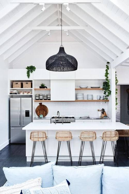 Coastal kitchen with boho chic style and open shelves